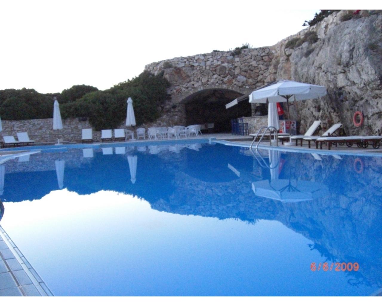 Bar woman at 5***** Hotel in Paros Island Greece (students)